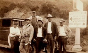 The Boss: Daniel 3rd, 1920 in white cap holding document
