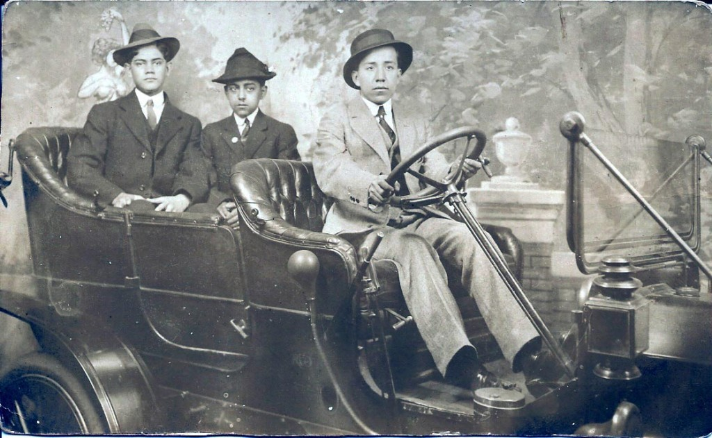 Honorio (foreground in back seat) poses with two friends